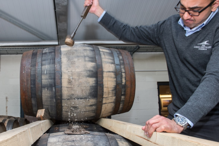 Lakes Distillery expert opening a cask of whisky